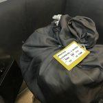 Мешок с одеждой и метками